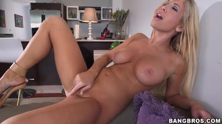 Glamour blonde chick Tasha Reign got on couch totally naked and spreading legs to masturbate her shaved twat.