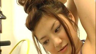 The boobs of horny Hitomi Aizawa bounce while she spins hula hoop