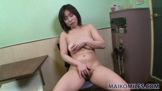 Horny japanese MILF Yumi Ohno playing with herself in an office